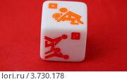 Купить «Кубик с эротическими рисунками на красном фоне», видеоролик № 3730178, снято 8 января 2011 г. (c) Losevsky Pavel / Фотобанк Лори