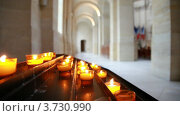 Купить «Зажженные свечи в католической церкви», видеоролик № 3730990, снято 23 февраля 2011 г. (c) Losevsky Pavel / Фотобанк Лори