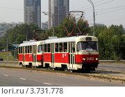 Купить «Красный трамвай на Строгинском мосту, маршрут №30», фото № 3731778, снято 7 августа 2012 г. (c) Андрей Ерофеев / Фотобанк Лори