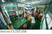 Купить «Дети стреляют из воздушного ружья шарами в игровой комнате», видеоролик № 3737318, снято 16 июля 2011 г. (c) Losevsky Pavel / Фотобанк Лори