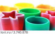 Купить «Пластиковые разноцветные игрушки-спирали на белом фоне», видеоролик № 3740878, снято 18 мая 2011 г. (c) Losevsky Pavel / Фотобанк Лори