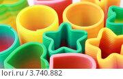 Купить «Пластиковые разноцветные игрушки-спирали на белом фоне», видеоролик № 3740882, снято 5 мая 2011 г. (c) Losevsky Pavel / Фотобанк Лори