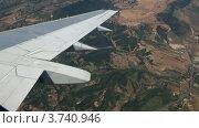 Купить «Вид на горы из иллюминатора самолета», видеоролик № 3740946, снято 19 мая 2006 г. (c) Losevsky Pavel / Фотобанк Лори