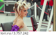 Купить «Девушка с необычной прической», видеоролик № 3757242, снято 3 октября 2011 г. (c) Losevsky Pavel / Фотобанк Лори