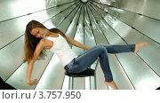 Купить «Модель позирует на стуле на фоне зонтика в фотостудии», видеоролик № 3757950, снято 24 ноября 2011 г. (c) Losevsky Pavel / Фотобанк Лори