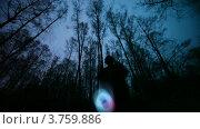 Купить «Человек играет со светящейся игрушкой в темном лесу, замедленная съемка», видеоролик № 3759886, снято 21 августа 2011 г. (c) Losevsky Pavel / Фотобанк Лори