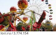 Купить «Аттракционы в парке Сокольники(таймлапс)», видеоролик № 3774154, снято 10 января 2012 г. (c) Losevsky Pavel / Фотобанк Лори