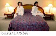 Купить «Мужчина и женщина в банных халатах входят в спальню и садятся на кровать, каждый со своей стороны», видеоролик № 3775698, снято 12 марта 2012 г. (c) Losevsky Pavel / Фотобанк Лори