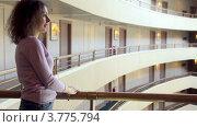 Купить «Женщина стоит на балконе многоэтажного здания», видеоролик № 3775794, снято 11 марта 2012 г. (c) Losevsky Pavel / Фотобанк Лори