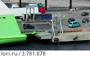 Купить «Машины съезжают с парома в порту летним днем», видеоролик № 3781878, снято 15 июня 2012 г. (c) Losevsky Pavel / Фотобанк Лори