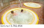 Купить «Дети сидят в бассейне с горячей водой», видеоролик № 3782854, снято 18 мая 2012 г. (c) Losevsky Pavel / Фотобанк Лори