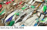 Купить «Кучи отходов картона для переработки, крупным планом вид в движении», видеоролик № 3784494, снято 24 июня 2012 г. (c) Losevsky Pavel / Фотобанк Лори