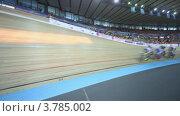 Купить «Несколько велосипедистов ездят по треку во время гонки на стадионе», видеоролик № 3785002, снято 17 июля 2012 г. (c) Losevsky Pavel / Фотобанк Лори