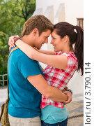 Купить «Молодая пара обнимается на фоне улицы», фото № 3790114, снято 26 мая 2012 г. (c) CandyBox Images / Фотобанк Лори