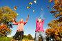 Две счастливые девушки играют в парке с осенними листьями, фото № 3806134, снято 2 октября 2011 г. (c) Дмитрий Калиновский / Фотобанк Лори