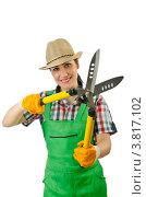Купить «Девушка в шляпе, рабочем комбинезоне и резиновых перчатках держит в руках садовые ножницы», фото № 3817102, снято 4 июня 2012 г. (c) Elnur / Фотобанк Лори
