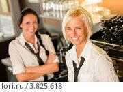 Купить «Улыбающиеся официантки в форме», фото № 3825618, снято 28 июля 2012 г. (c) CandyBox Images / Фотобанк Лори