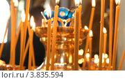 Купить «Горящие свечи на подсвечнике», видеоролик № 3835594, снято 14 сентября 2012 г. (c) Mikhail Erguine / Фотобанк Лори