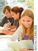Купить «Друзья-студенты в аудитории», фото № 3849358, снято 21 августа 2012 г. (c) CandyBox Images / Фотобанк Лори