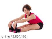 Купить «Девушка в красной майке делает гимнастику, упражнения», фото № 3854166, снято 1 мая 2012 г. (c) Tatjana Romanova / Фотобанк Лори