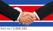 Купить «Мужчины пожимают руки на фоне флага Северной Кореи», фото № 3868342, снято 19 октября 2018 г. (c) Александр Макаров / Фотобанк Лори