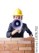 Купить «Женщина-строитель с громкоговорителем за кирпичной стеной», фото № 3878702, снято 27 июля 2012 г. (c) Elnur / Фотобанк Лори