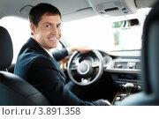 Купить «Счастливый мужчина в костюме за рулем автомобиля бизнес-класса», фото № 3891358, снято 4 августа 2012 г. (c) Raev Denis / Фотобанк Лори