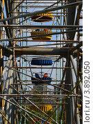 Купить «Аттракцион (чертово колесо)», фото № 3892050, снято 7 августа 2012 г. (c) Наталья Спиридонова / Фотобанк Лори