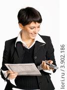 Купить «Деловая женщина с телефоном и газетой, белый фон», фото № 3902186, снято 19 октября 2007 г. (c) Иван Михайлов / Фотобанк Лори