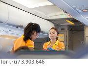 Купить «Филиппины. Стюардессы авиакомпании Cebu Pacific Air в салоне самолета», фото № 3903646, снято 1 мая 2012 г. (c) Сергей Дубров / Фотобанк Лори