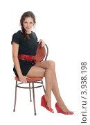 Симпатичная девушка в коротком черном платье сидит на стуле, фото № 3938198, снято 21 декабря 2011 г. (c) Argument / Фотобанк Лори