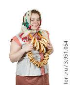 Купить «Молодая женщина в традиционных русских одеждах с баранками на белом фоне», фото № 3951054, снято 15 октября 2011 г. (c) Яков Филимонов / Фотобанк Лори