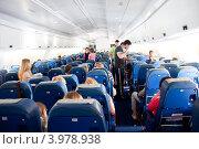 Купить «В салоне самолета Ил-96. Чартерный рейс», эксклюзивное фото № 3978938, снято 17 июня 2012 г. (c) Володина Ольга / Фотобанк Лори