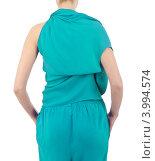 Купить «Модные тенденции. Модель в бирюзовом платье с асимметрчным верхом стоит спиной», фото № 3994574, снято 4 апреля 2012 г. (c) Elnur / Фотобанк Лори
