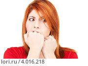 Купить «Расстроенная девушка кусает кулаки на белом фоне», фото № 4016218, снято 10 октября 2009 г. (c) Syda Productions / Фотобанк Лори