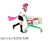 Купить «Девушка в вязаной розовой шапке и шарфе с тележкой покупок на белом фоне», фото № 4016538, снято 4 октября 2009 г. (c) Syda Productions / Фотобанк Лори