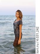 Купить «Девушка подросток в мокрой одежде в море», фото № 4031242, снято 12 июля 2011 г. (c) Сергей Сухоруков / Фотобанк Лори
