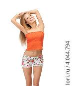 Купить «Юная симпатичная девушка в коротких шортах и топике на белом фоне», фото № 4044794, снято 25 июня 2012 г. (c) Syda Productions / Фотобанк Лори
