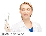 Купить «Привлекательный дантист со стоматологическими инструментами в руках», фото № 4044970, снято 17 апреля 2011 г. (c) Syda Productions / Фотобанк Лори