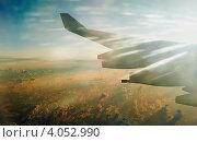 Под крылом самолета. Стоковое фото, фотограф Ольга Полякова / Фотобанк Лори