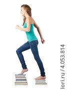 Купить «Студентка идет вверх по ступенькам из книг на белом фоне», фото № 4053814, снято 22 августа 2012 г. (c) Elnur / Фотобанк Лори