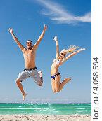 Купить «Счастливые молодой человек и привлекательная девушка на песочном пляже на фоне моря и синего неба летним днем», фото № 4058594, снято 27 июня 2019 г. (c) Syda Productions / Фотобанк Лори