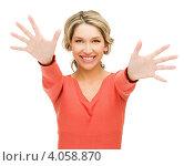 Купить «Жизнерадостная блондинка в красном свитере протягивает ладони на белом фоне», фото № 4058870, снято 24 марта 2012 г. (c) Syda Productions / Фотобанк Лори