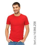 Купить «Привлекательный молодой человек в красной футболке на белом фоне», фото № 4066258, снято 7 октября 2012 г. (c) Syda Productions / Фотобанк Лори