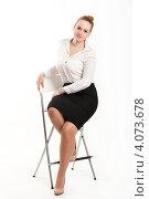 Купить «Деловая женщина сидит на высоком стуле», фото № 4073678, снято 2 декабря 2012 г. (c) Володина Ольга / Фотобанк Лори