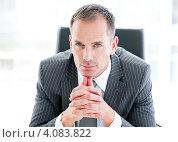 Купить «Портрет элегантного бизнесмена в офисе», фото № 4083822, снято 21 августа 2018 г. (c) Wavebreak Media / Фотобанк Лори