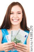 Купить «Юная девушка с деньгами в руках на белом фоне», фото № 4085270, снято 7 ноября 2009 г. (c) Syda Productions / Фотобанк Лори