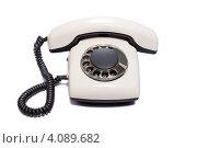 Купить «Старый дисковый телефон на белом фоне», фото № 4089682, снято 20 июля 2012 г. (c) Юрий Бизгаймер / Фотобанк Лори
