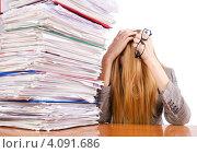 Купить «Блондинка склонила голову перед горой документов в офисе», фото № 4091686, снято 28 сентября 2012 г. (c) Elnur / Фотобанк Лори