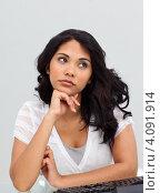 Купить «Задумчивая девушка за клавиатурой», фото № 4091914, снято 30 октября 2009 г. (c) Wavebreak Media / Фотобанк Лори